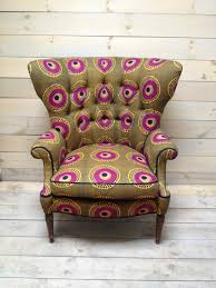 african print home decor mid century fanback armchair upholstered in olive and magenta