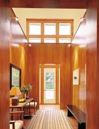 architecture interior design by victoria hagan interiors the double height hall of a new jersey home is grounded by an interior room paneled