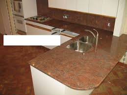 Cutting Kitchen Cabinets Granite Countertop Copper Kitchen Cabinets Black Backsplash