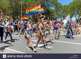 Flags In Lgbt Community And Supporters Walking And Carrying Flags In The