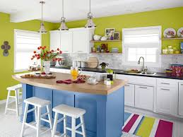 green wall color with blue kitchen island design and stylish white