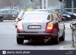 new bentley sedan xavier naidoo leaving hyatt hotel with his new bentley featuring