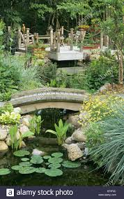 cedar bridge and viewing deck over garden pond minneapolis stock
