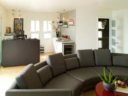 contemporary style living room with oversized gray curved sofa