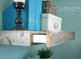 Floating Wood Shelves Diy by Reclaimed Wood Floating Shelves Stacy Risenmay