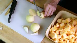 A Chef Slicing A Pumpkin by Chef Slicing A Potato On A Small Cutting Board Stock Footage Video