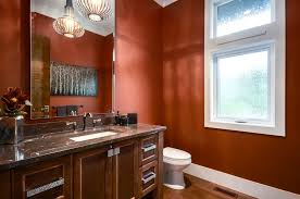 burnt orange paint color powder room transitional with brown