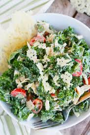 kale salad for thanksgiving shredded chicken kale caesar salad with parmesan crisps table