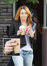 a guide to miley cyrus u0027 ever growing tattoo collection and what