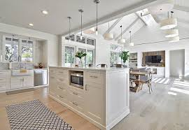 open floor plan kitchen and family room with shiplap wall and