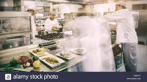Professional Kitchen Chefs Busy At Work In Professional Kitchen Stock Photo Royalty