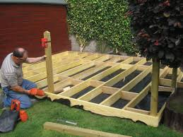 small decked garden ideas patio and decking with grass design