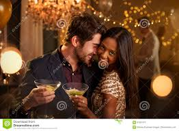 romantic couple enjoying cocktail party together stock photo