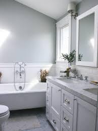 modern white tile bathroom bronze door handles glass shower door