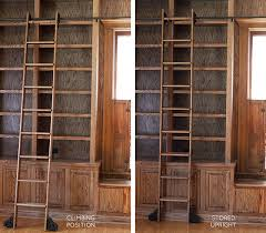 the built in bookshelves and rolling ladder in the library