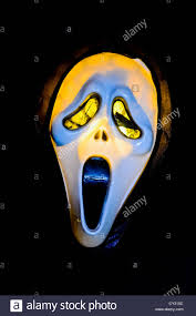 halloween ghost mask shot against black background stock photo