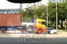 what is considered running a red light 1 injured after trailer truck rams car in singapore asean east