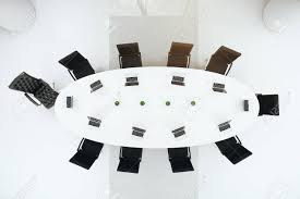 concrete conference room interior with round table chairs view