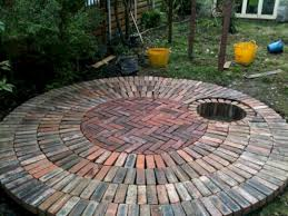 brick patio with recessed fire pit including a hidden air feed