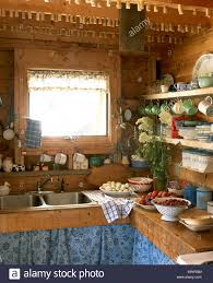 wooden country kitchen with eggs and fruit stock photo royalty