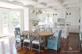 round gray dining table with purple dining chairs transitional