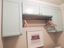laundry room revealed laundry rooms dryer and washer for a functional laundry room configuration place a rod between two vertically long cabinets to