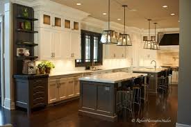galley style kitchen with island speedlights for real estate photography
