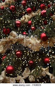 christmas tree with white lights and red bows christmas garland red balls and bows decoration isolated on white