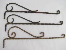 lot vintage wrought iron hangers or sign holders antique curtain rods