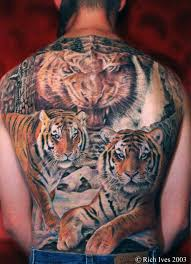 realism style colored back of big tiger family
