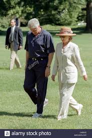 president bill clinton and first lady hillary clinton return from