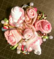 baby sock corsage baby shower gifts from bling to baby shower shoppe