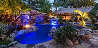 custom rock waterfall pool grotto spa natural stream tiki hut