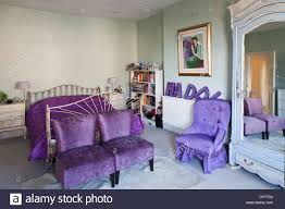 wrought iron bed in traditional style bedroom with vibrant purple