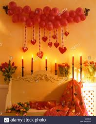 Lighted Balloons Garland Of Red Balloons And Red Hearts On Wall Above Lighted