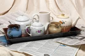 turn teapots into an ornamental tea tray
