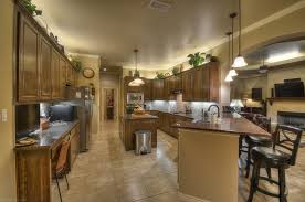 floor and decor granite countertops mediterranean kitchen with pendant light built in bookshelf