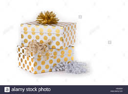 polka dot boxes polka dot gift boxes in gold and white with ribbons stock photo