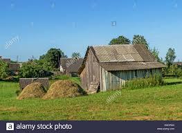 village garden barns and green grass yard stock photo royalty