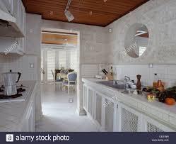 modern galley kitchens circular internal window above sink in modern galley kitchen with