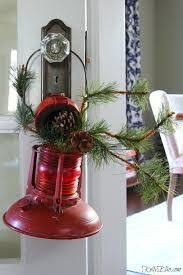 vintage red lantern filled with christmas greens kellyelko com