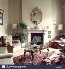 Mirror Living Room Tables Oval Mirror Above Marble Fireplace In Beige Eighties Living Room
