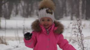 happy child in the park on a winter day