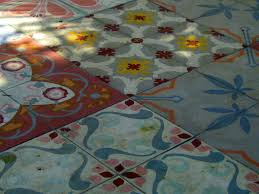 tyler likes this idea for a spanish tile floor in the kitchen that