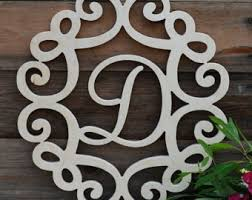 painted wooden monogram in filigree frame wood monogram