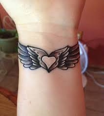 lovely small heart wings tattoo on wrist golfian com
