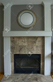 stacked stone veneer fireplace installation black wood white