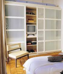 u shaped walk in closet with white painted wooden shelving brown