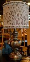 exotic cheetah print always goes with everything bejeweled animal exotic cheetah print always goes with everything bejeweled animal print lamp shade on a bronze