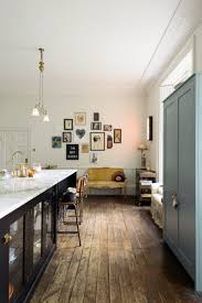 15 best our legacy images on pinterest mustard foods and charming vintage style kitchen in frome designed by devol with distressed wood flooring long island shaker style cabinetry and a unique gallery wall of